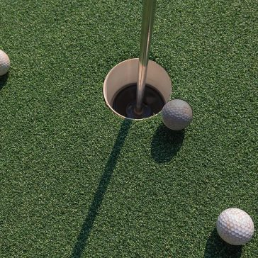 Golf hole and balls