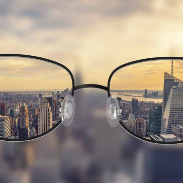Clarity of vision looking through glasses at city skyline