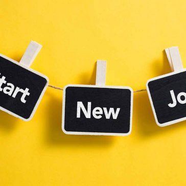 cards pegged on string saying start new job