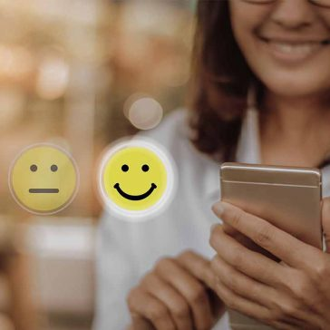 Mobile phone user showing happy face