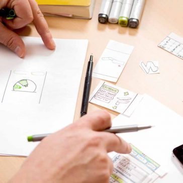 Person designing on paper