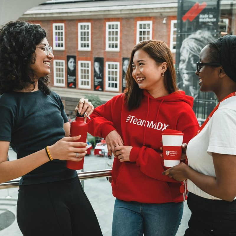 Middlesex University creative chatbot case study image showing students chatting on university campus