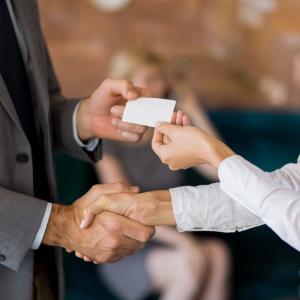 Exchanging business cards at a networking event.